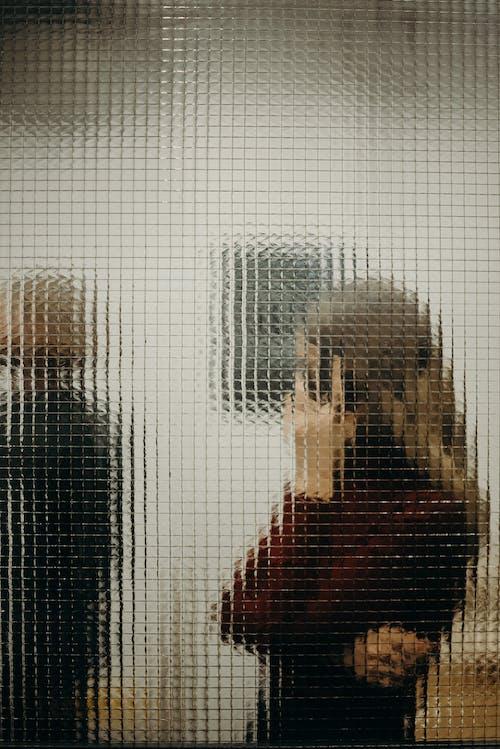People Behind Glass