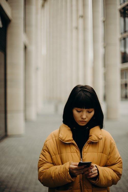 Woman Wearing Yellow Bubble Jacket