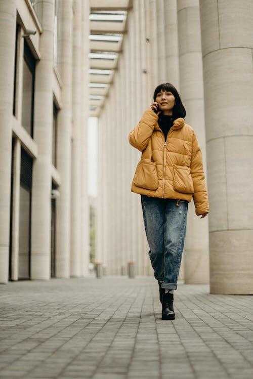 Woman Wearing Yellow Coat