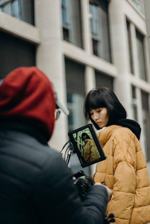 Woman Standing Near Camera