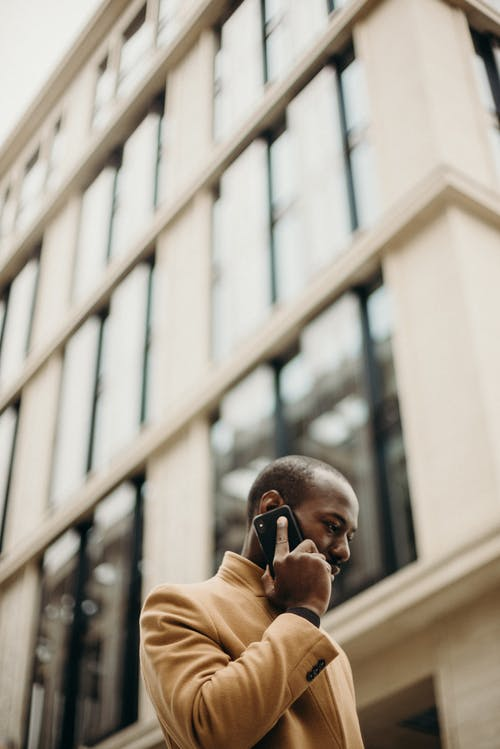 Man Holding Phone on His Ear