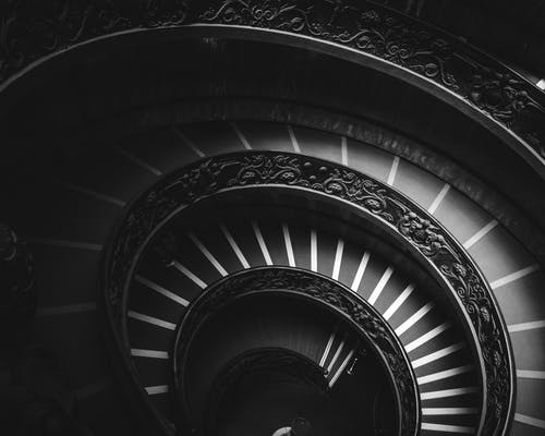 Grayscale Photography of Spiral Stairs