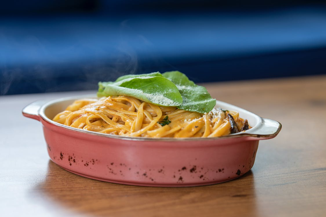 Pasta With Basil Leaves on Top