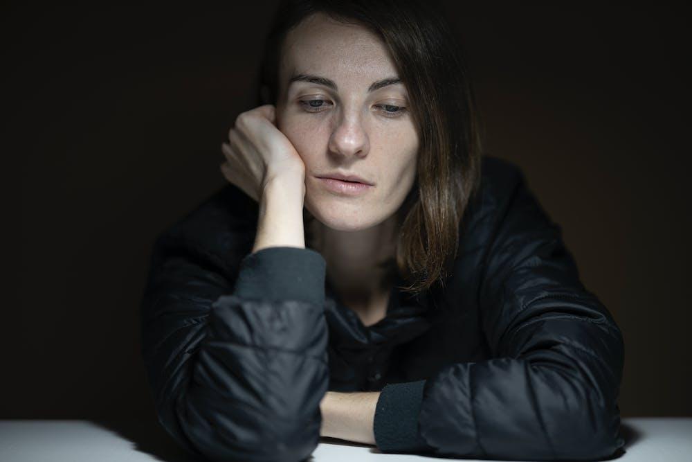 Sad woman in black ensemble. | Photo: Pexels