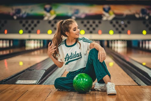 Woman Sitting in A Bowling Alley