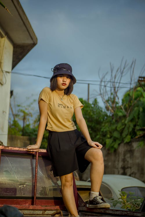Woman in Yellow Crew Neck T-shirt and Black Shorts