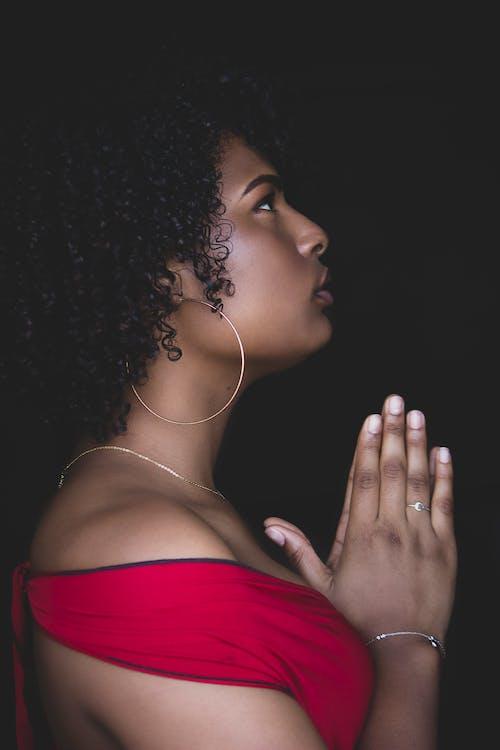 Woman in Red Top Praying