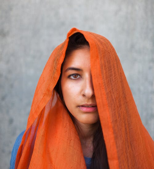 Woman Covering Head With Orange Scarf