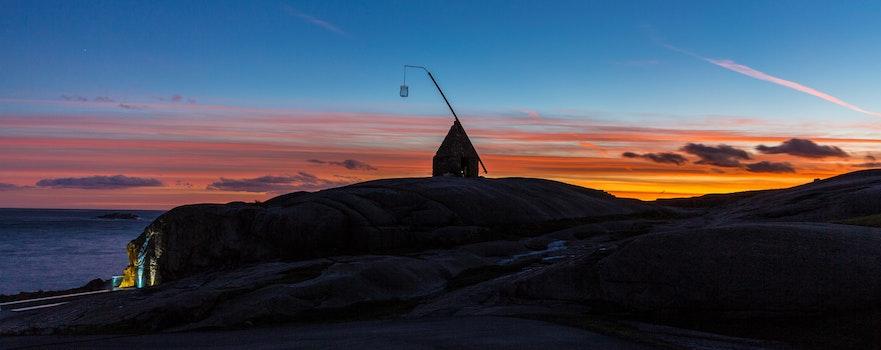 Free stock photo of sunset, lighthouse, colors, orange skies