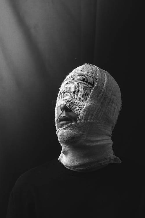 Grayscale Photography of Person's Face Covered With Gauze