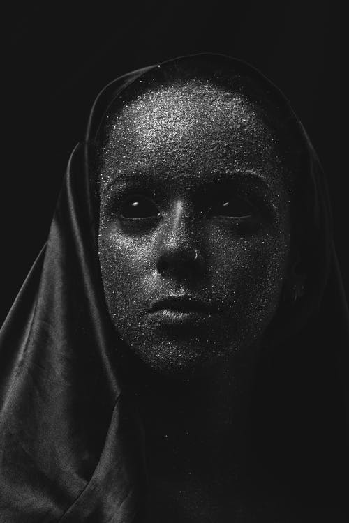 Woman's Face Covered With Glitters