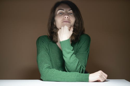 Woman in Green Sweater