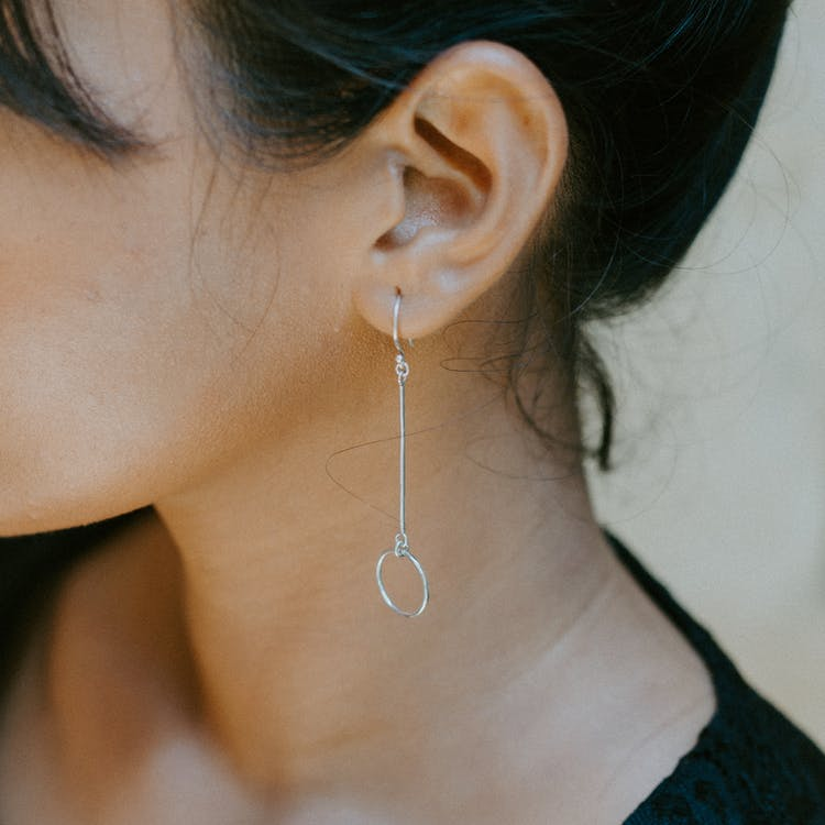 Woman Wearing Silver-colored Earring - Look After Your Ear Health