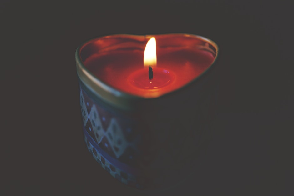 Close-up of Tea Light Candle Against Black Background