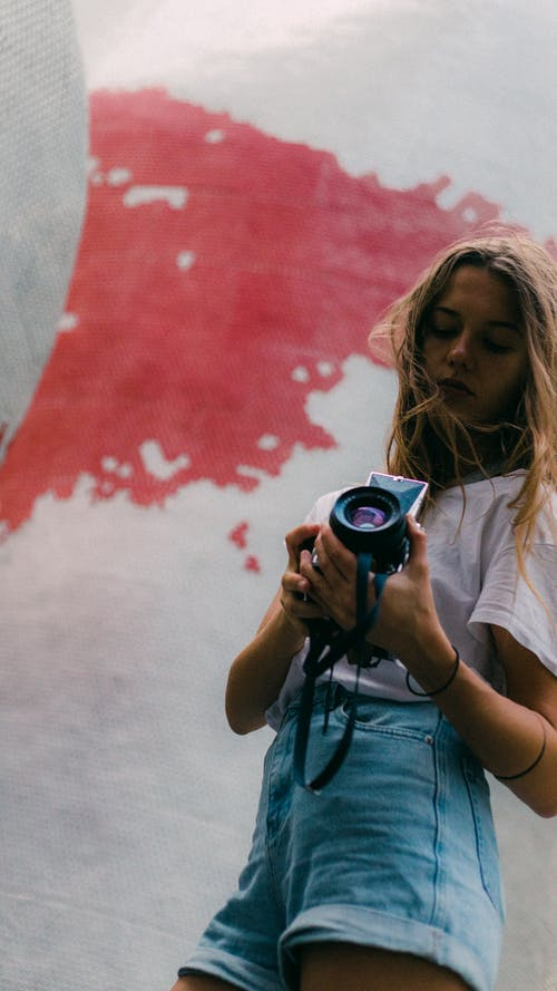 Woman Holding Black Camera