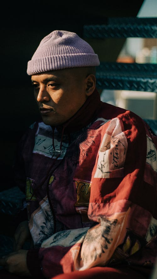 Side View Of A Man in Red and White Jacket