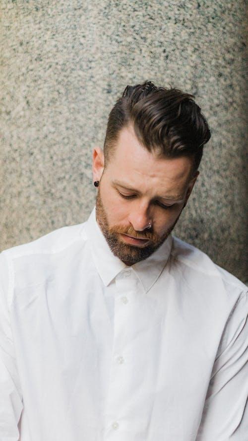Man in White Dress Shirt Looking sad