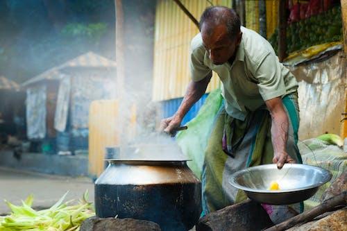 Man Cooking Outdoor