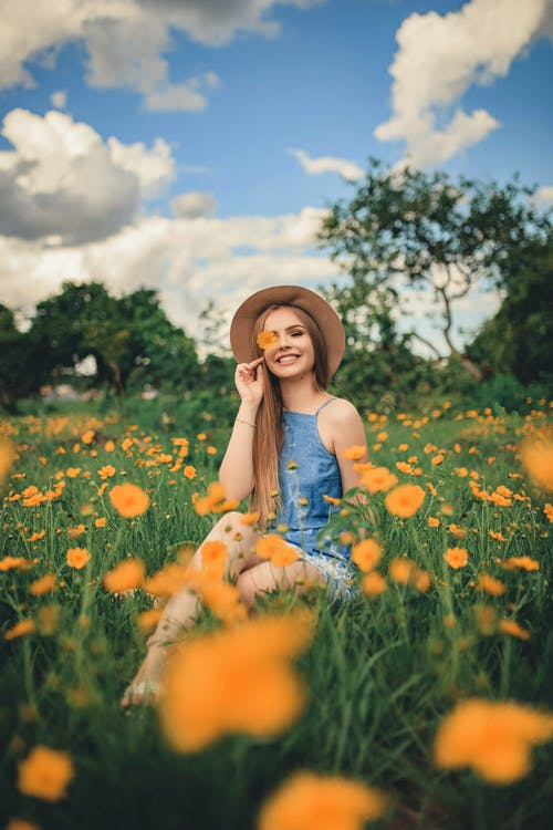 Woman Sitting on Flower Field