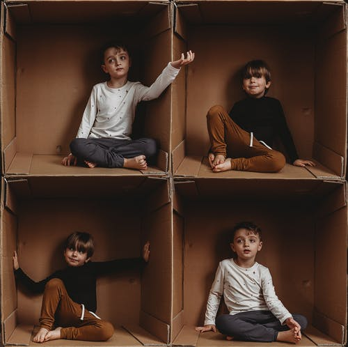 Photo Of Boys Sitting On Box