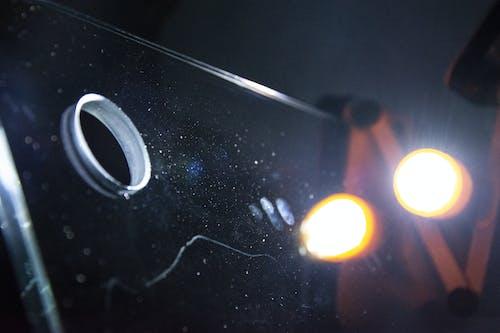 Gratis stockfoto met lampen, macro, reflectie, stof