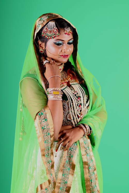 Woman Wearing Green and Beige Floral Sari Dress