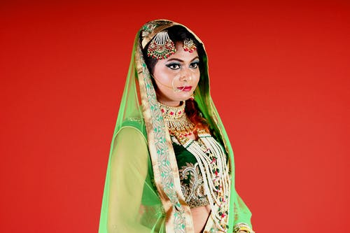 Woman Wearing Green and White Floral Sari Dress