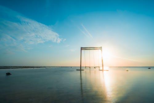 Foto d'estoc gratuïta de balancejar, capvespre, cel, Costa