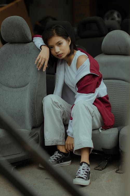 Photo Of Woman Sitting On Car Seat
