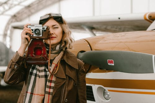 Photo Of Woman Standing Beside Airplane