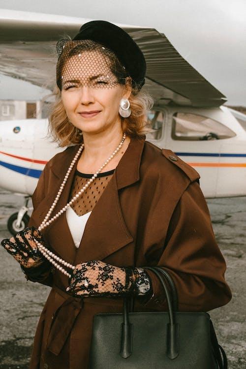 Woman Standing Near Airplane