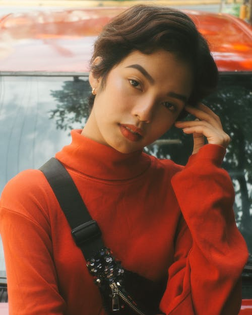 Woman Wearing Red Turtleneck Top