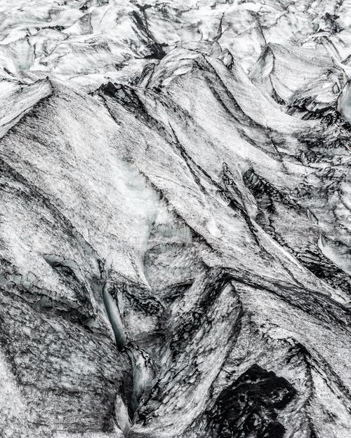 Close Up Photo of Black and White Rock Formation