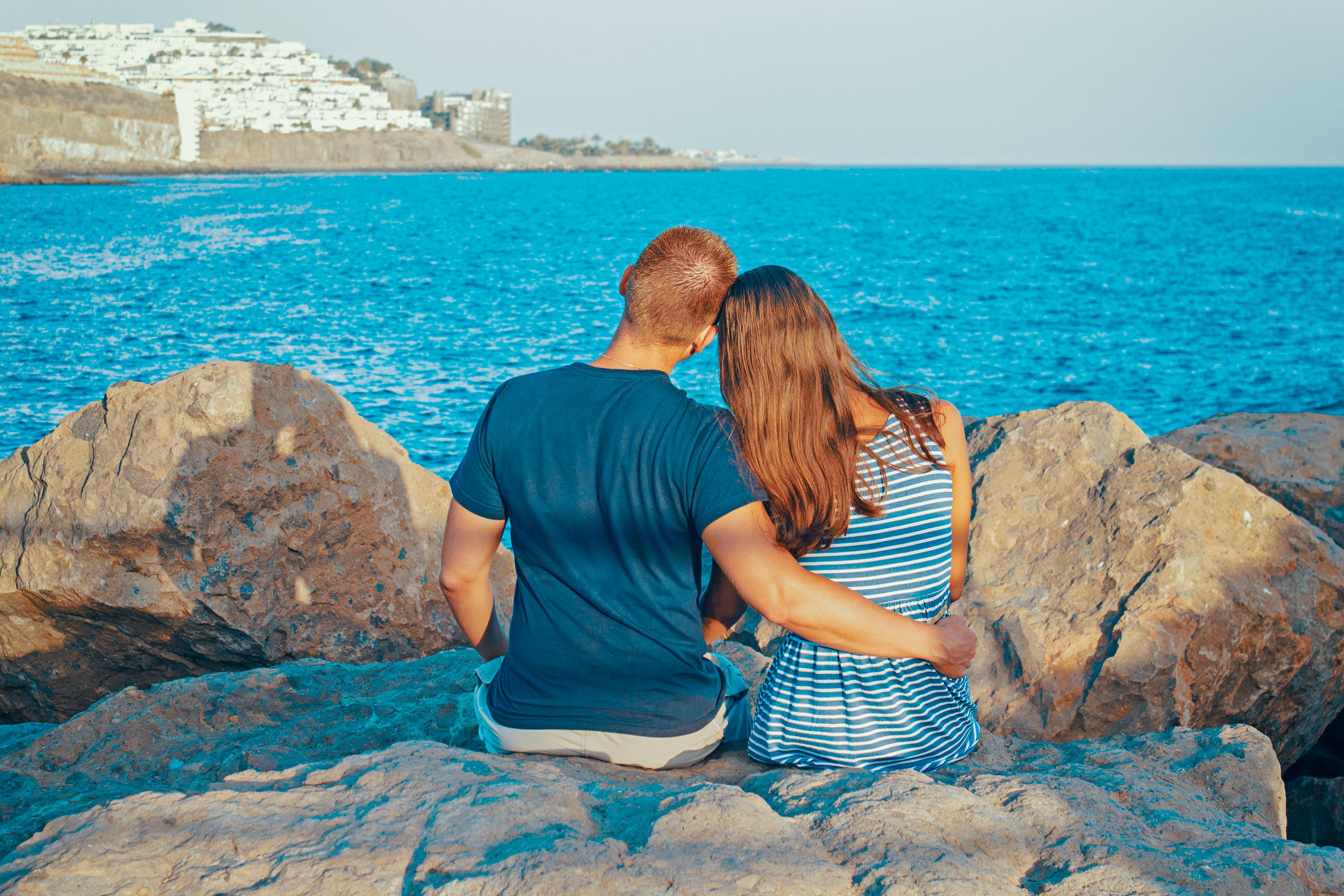 Rear View of Couple Sitting on Beach