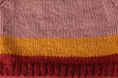 Free stock photo of burgundy, golden yellow, knitwear, pink