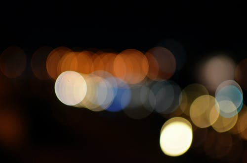 Orange, White, Blue, and Yellow Light Bokeh