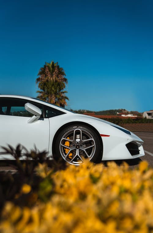 White Sports Car Parked Outside