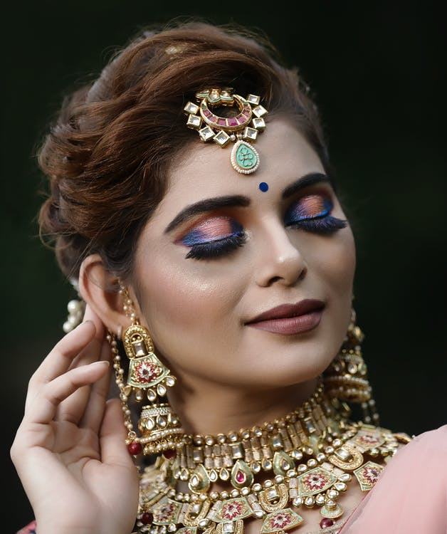 Woman Wearing Gold Accessories