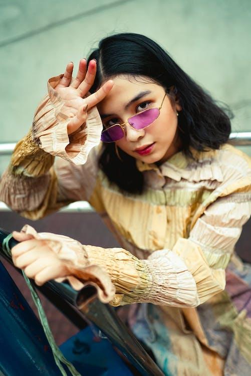 Photo Of Woman Wearing Purple Sunglasses