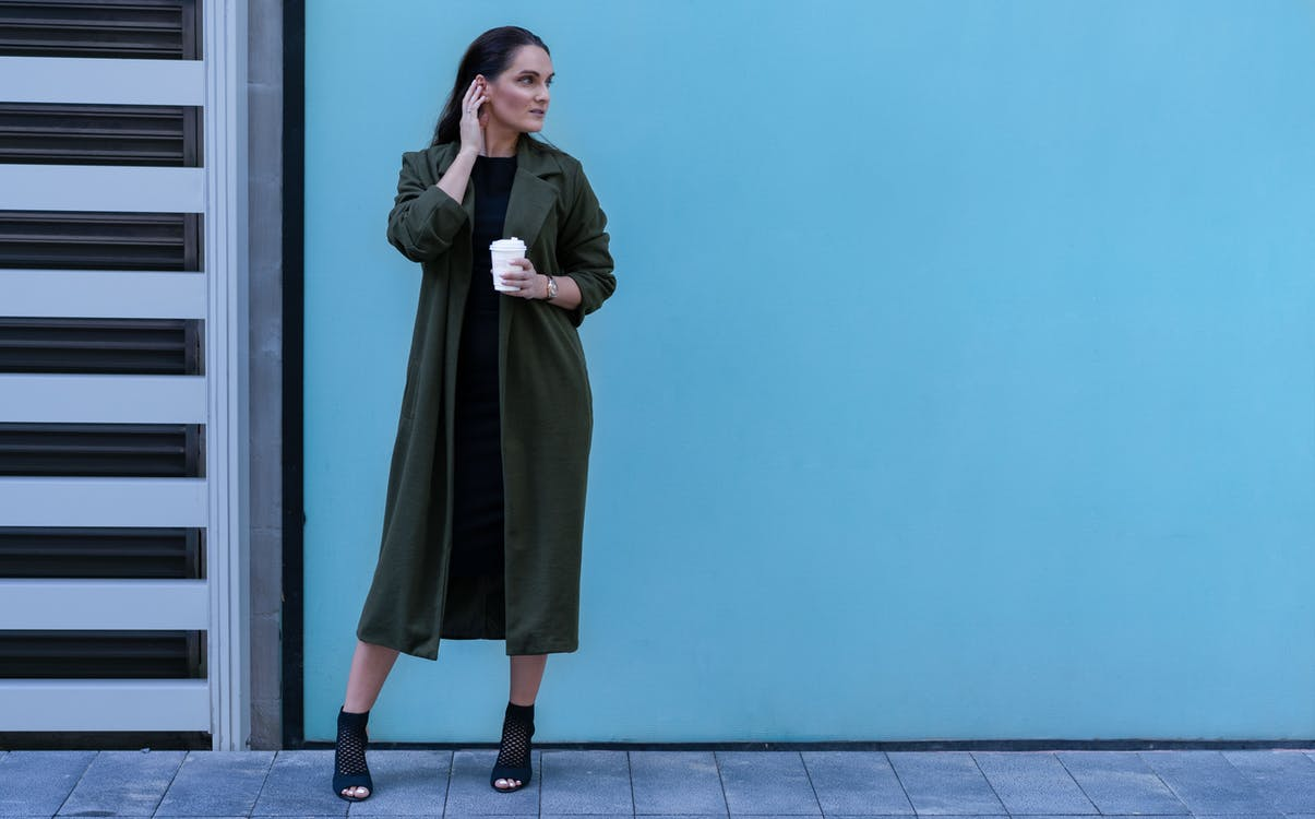 Photo Of Woman Wearing Green Coat