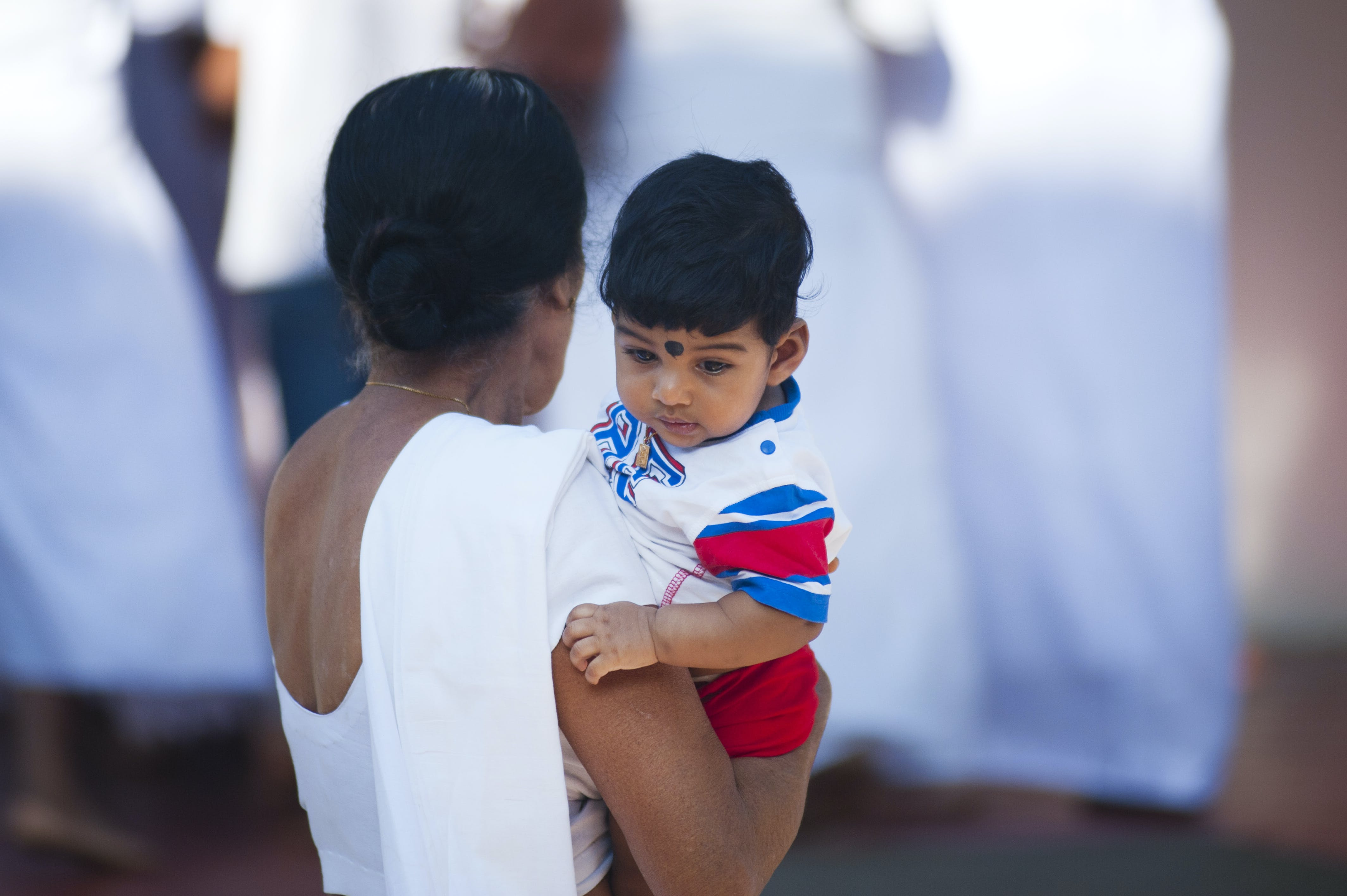 Selective Focus Photography of Woman Holding Child