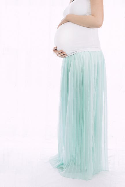 Pregnant Woman Standing In Front Of White Wall  Free -6244