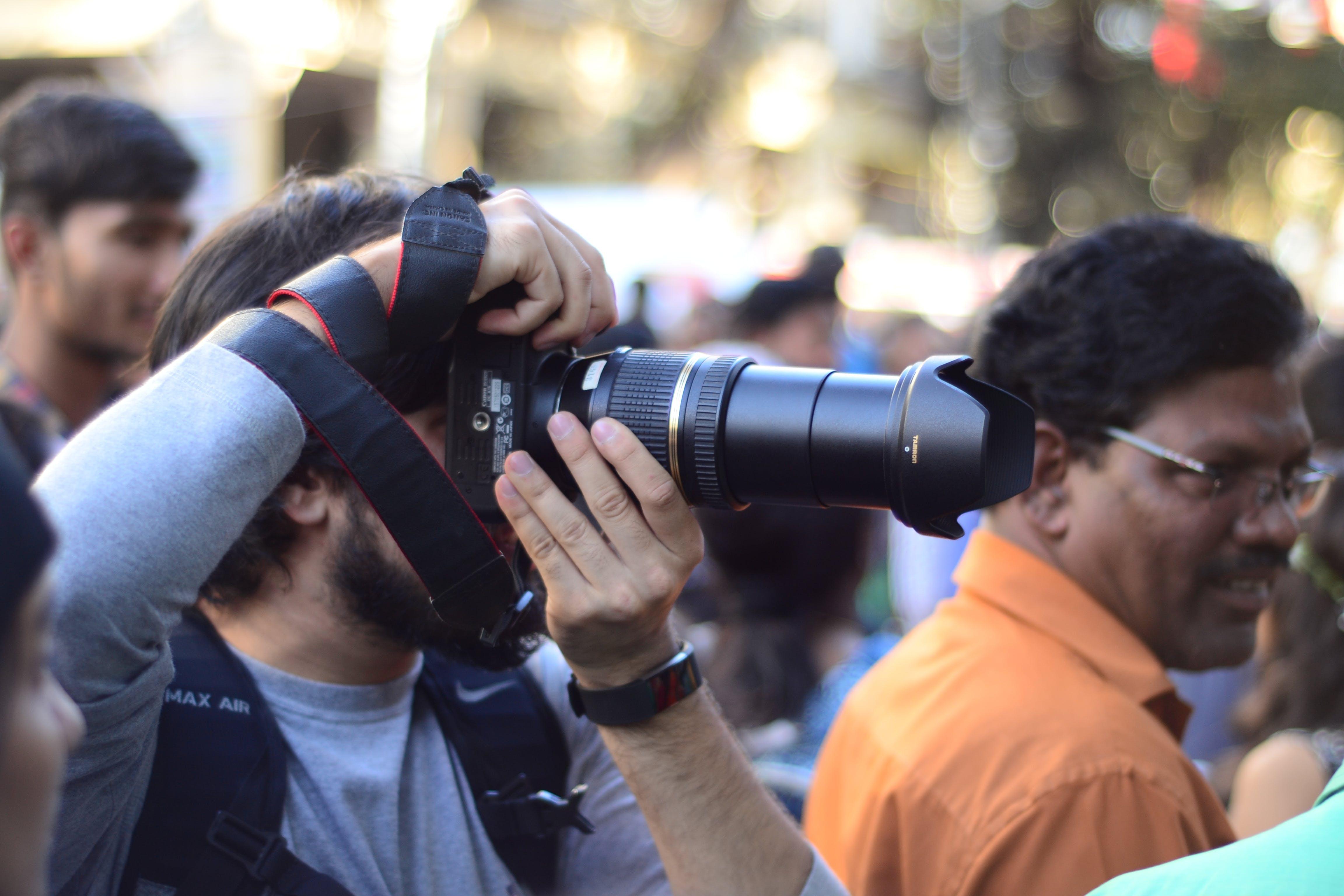 Free stock photo of bokeh, camera, camera equipment, cameraman