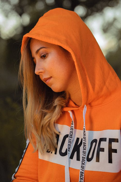 Photo Of Person Wearing Orange Hoodie