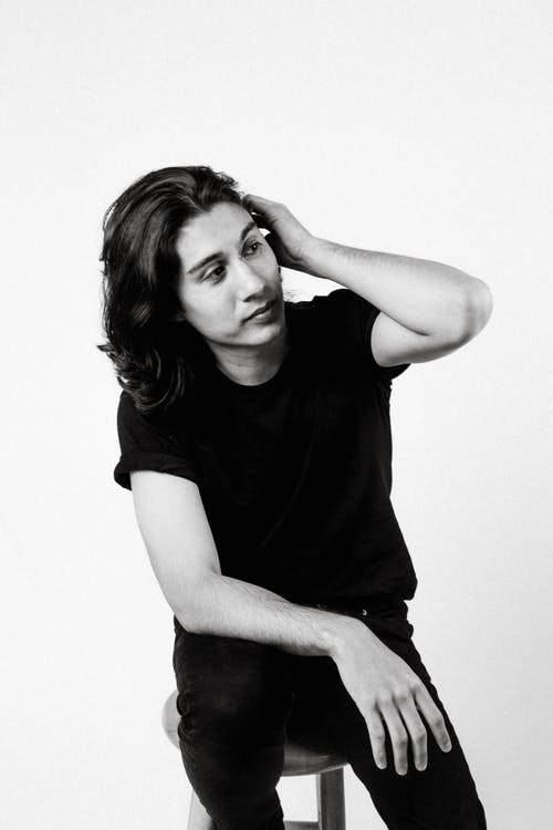 Monochrome Photo of Man Wearing Black Shirt