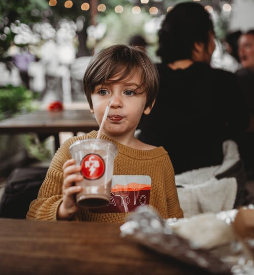 Child Drinking a Chocolate Beverage