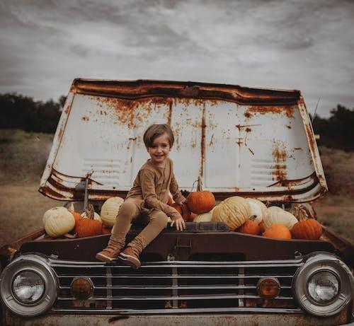 Photo Of Kid Sitting On Truck