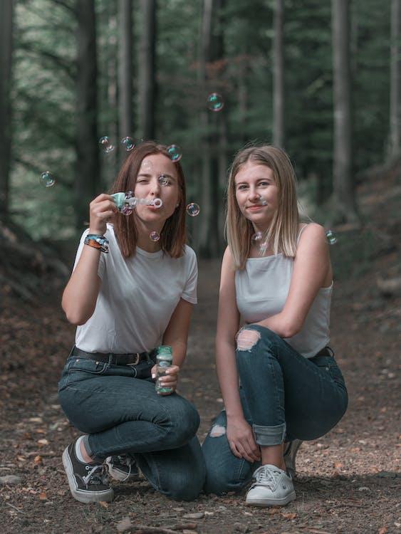 Photo of Women Kneeling Near Bubbles