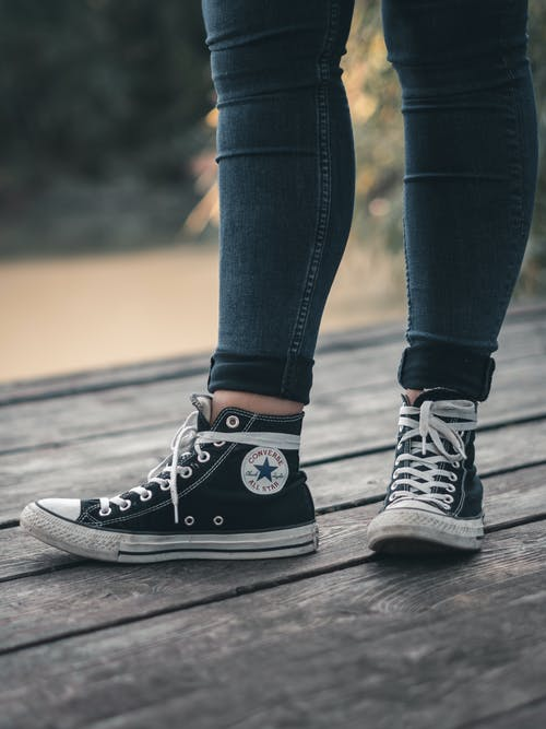 Photo of Person Wearing Converse All Star