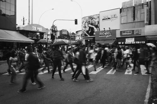 Monochrome Photo of People Walking on Pedestrian Crossing